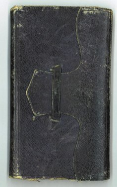 A leather bound notebook with a closing flap.