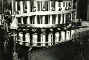 Cans of infant formula on a conveyor belt.