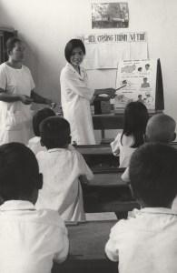 An Asian woman teaches a roomful of Asian children