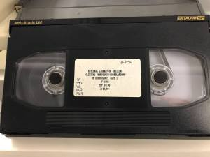 Close view of a BetacamSP cassette which resembles a larger version of a VHS tape.