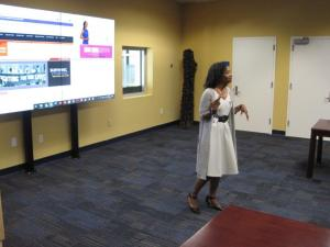 An African American woman gives a presentation