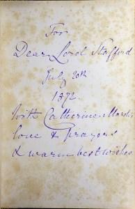 Handwritten cursive inscription in blue ink.