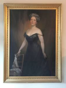 Gold Framed formal painted portrait of a middle aged white worman in a black gown.