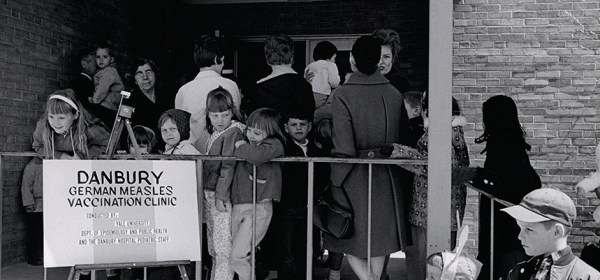 People gather outside a German Measles vaccination clinic.