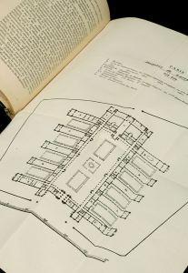 An open book showing a fold out chart of a floorplan..