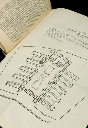 An open book showing a fold out chart of a floorplan..