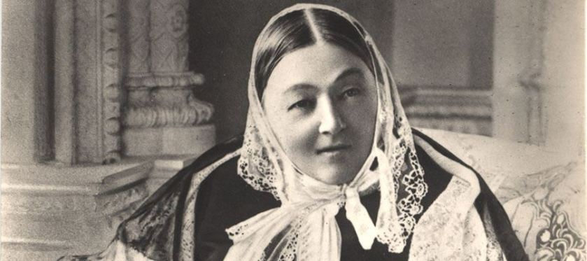 A photo portrait of a woman in a scarf.