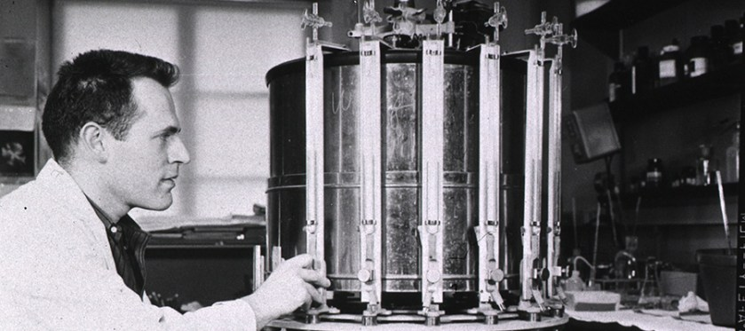 Photograph of a laboratory worker operating centrifuge.