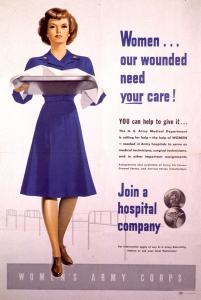 A woman in a blue uniform dress carries a covered tray.