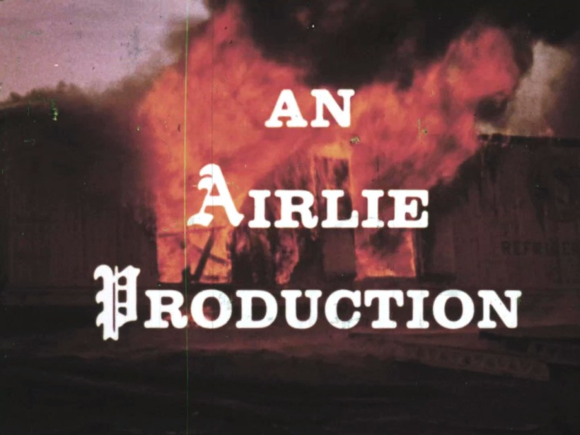 An Airlie Production text on top of an image with fire
