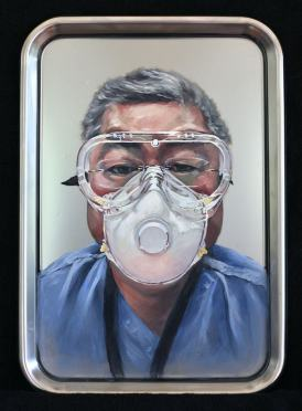 A painting of an older asian man in safety goggles and a mask wearing scrubs framed in a stainless steel tray.