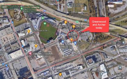 A Satellite image of modern Greenwood: a baseball stadium, an expressway,, shops, restarurants and empty lots. l