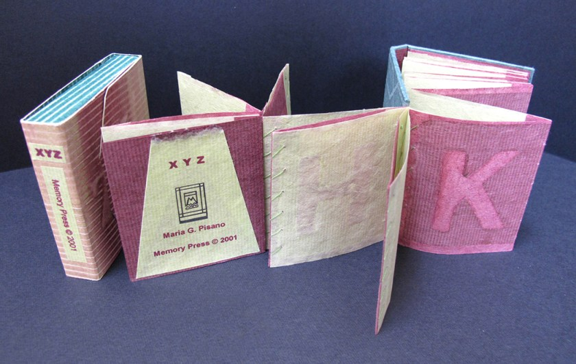A hand sewn book with textured pages and an accordion structure.