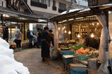 Food market selling  onsen-cooked vegetables.