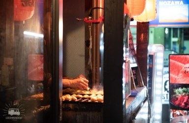 Everywhere are foodstalls. This one selling Takoyaki, balls of batter with squid/octopus.