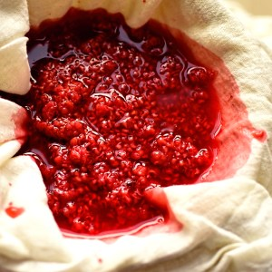 straining raspberry vinegar