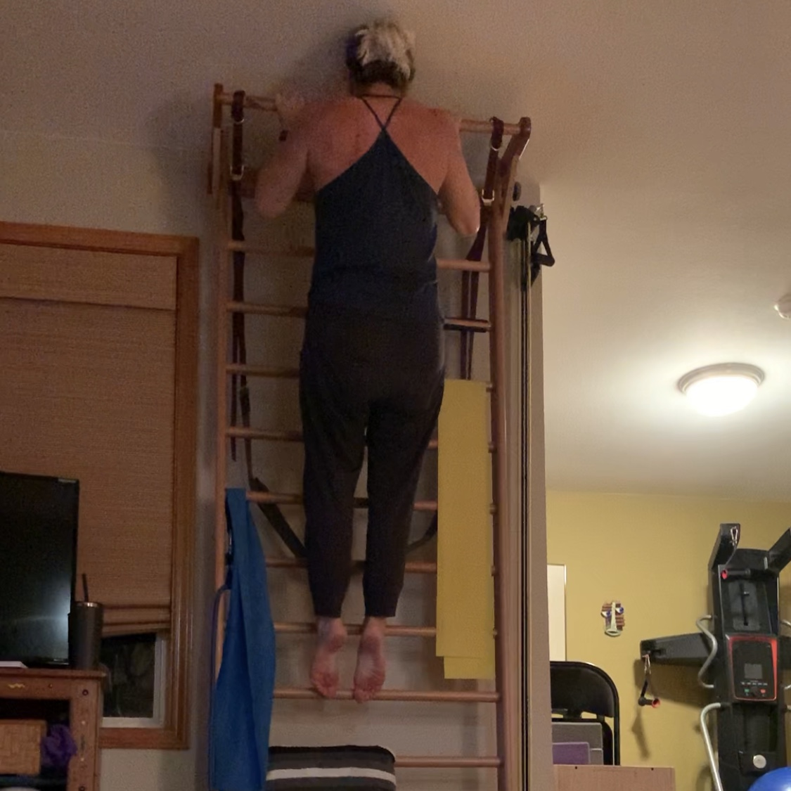 Pull-up tips for aerialists. Jessica John demonstrates the top of the pull-up motion.