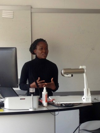 """Betty Wisiki presenting her work, """"An exploratory analysis of the experiences of Deaf students in accessing higher education in UK universities"""""""
