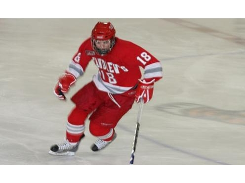 St. Andrews College hockey player in red uniform alone on the ice