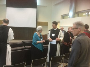 Scholars enjoy post-panel conversations at the Conference on Cistercian and Monastic Studies, 2016, during the Lee Honors College sessions.