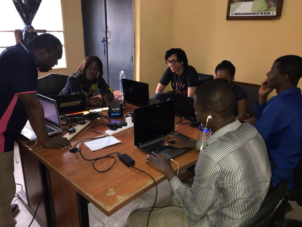 group of persons working with their laptops