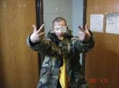 An unidentified military member flashes gang signs