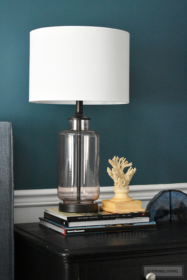 Modern coastal teen bedroom - Beautiful glass lamp, styled with coral and agate for a clean, coastal feel.