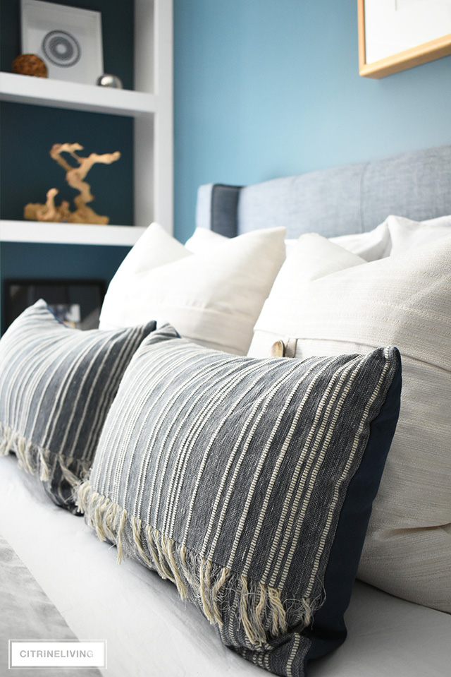 Modern coastal teen bedroom - striped and textured throw pillows for a luxurious, relaxing look