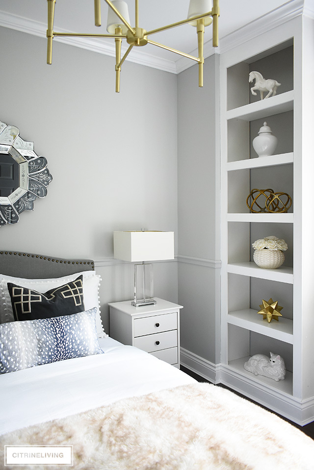 Beautifully styled bookshelves in this glam teen girl's bedroom, using white and brass for an elegant and chic look!