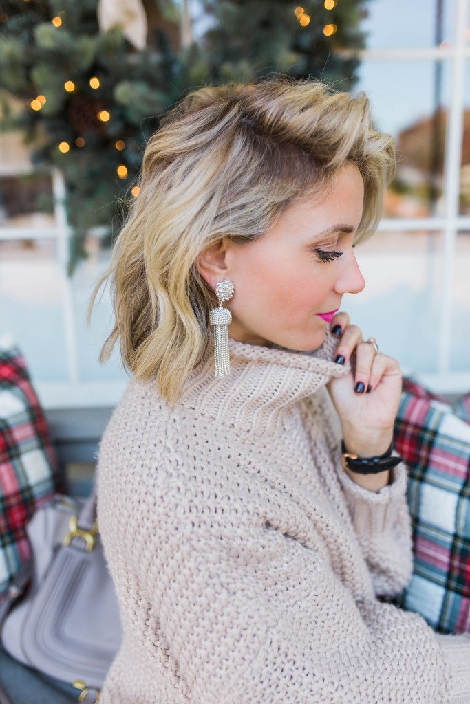 slouchy-sweater-holiday-outfits-LisiLerch-tassel-earrings-city-peach