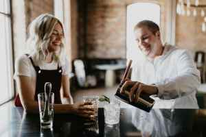 two people getting drinks
