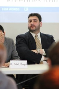 Dr. Osama Abu Irshaid listening to one of his peers speak. (Photo by Alex Wieber)