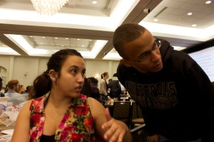 Robert Ellis confers with Amanda Gomes Torres, Metro South regional representative to the Governing Council from Normandale Community College on Oct. 18 at the MSCSA conference in Bloomington, MN.