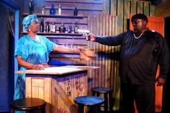 Mama Nadi (Chalethia Williams) and Commander Osembenga (Calvin Benford)
