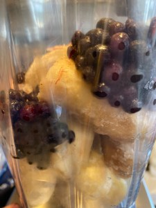 Bananas and wild blueberries in a blender- Wild Blueberry Smoothie Bowl- City Foodie Farm