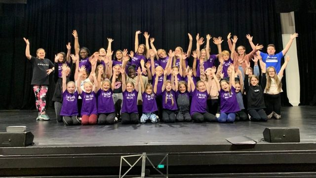 Young people on stage at the Civic Theatre