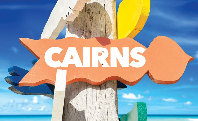 Cairns welcome sign with beach