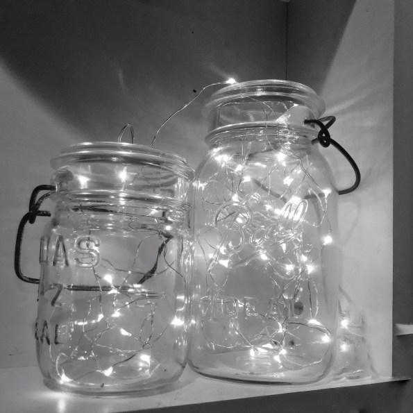 Twinkle holiday lights in vintage canning jars.