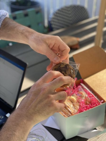 Man opening cookie box.
