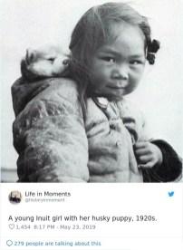Inuitka z mladičem huskyja, okoli 1920.