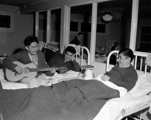 Harry Anaglik strums guitar as Roger Avrana and another roommate listen. January 3, 1950. EA-600-3574a City of Edmonton Archives