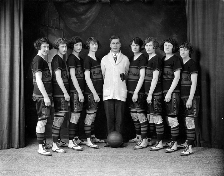 Edmonton Commercial Grads Basketball Team, 1924. L to R: Winnie Martin, Dorothy Johnson, Abbie Scott, Eleanor Mountifield, J. Percy Page - Coach, Connie Smith, Daisy Johnson, Nellie Perry, Mary Dunn. Image courtesy of the City of Edmonton Archives EA-765-2