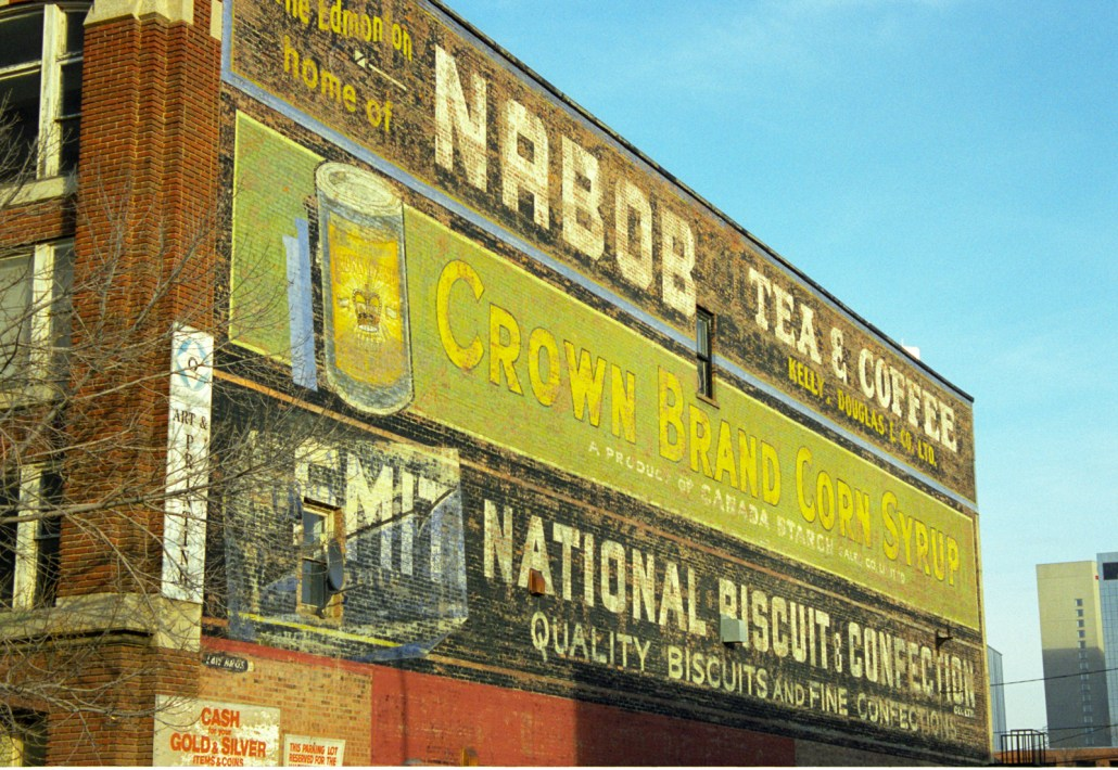 Painted sign on the side of the Shaw Building. Photo courtesy of Lawrence Herzog, November 1999.