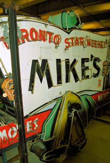 Mike's News sign in storage, 1998. Photo by Lawrence Herzog