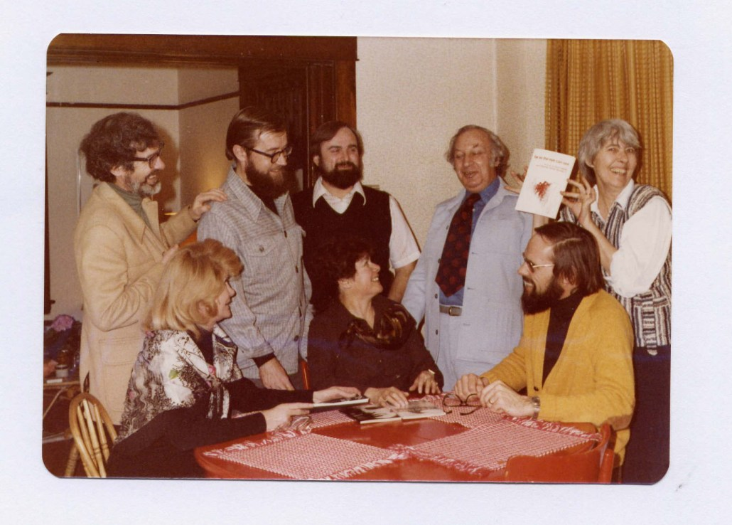 The editorial board of NeWest Press celebrating the publication of Rudy Wiebe's play AS FAR AS THE EYE CAN SEE c. 1978. Standing: (left to right) Norman Yates, who designed the cover of the book; Richard Harrison, Dept of English, U of Alberta, George Melnyk, publisher, Henry Kreisel, Dept of Comparative Literature, U of Alberta, Dianne Bessai (holding the book), Dept of English, University of Alberta. Seated: Irene Harrison, Esther Kreisel, and Rudy Wiebe. Image courtesy of NeWest Press, do not reproduce.