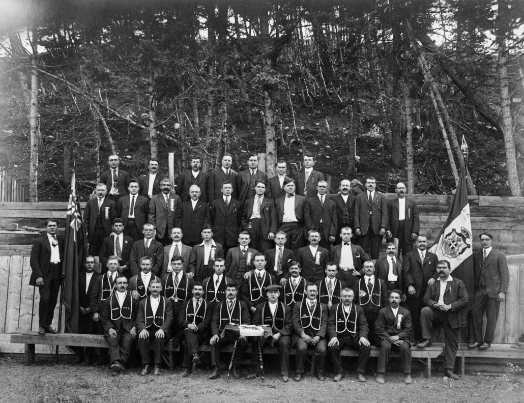 Italian men's society members, [Ordine Indipendente Fior D'Italia], Crowsnest Pass area, Alberta circa 1922. Image courtesy fo the Glenbow Archives NA-3903-87.