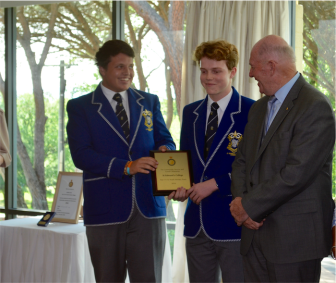 Sir Peter Cosgrove presenting an award to the year 11 and 12 Youth Ministry Team from St Edmund's College.