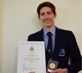 Ben Jenkins from St Mary MacKillop College holding his ACT Student Citizenship Award.