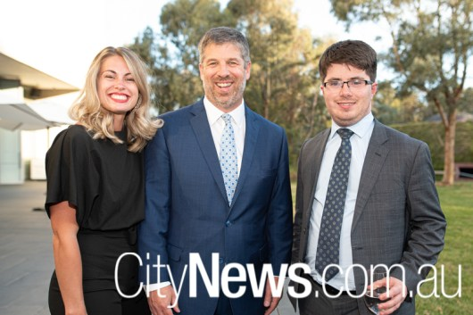 Law Council of Australia's outgoing CEO Jonathan Smithers, centre, with wife Felicity and Zac Smith