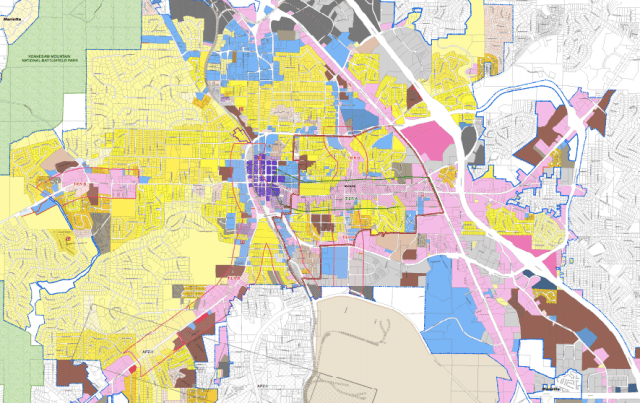 A zoning map of Marietta. Yellow areas are zoned for single-family homes only; brown areas are set aside for apartments. The large brown area in the southeast corner contains the homes to be razed. Pink is commercial. Source: Marietta, GA website